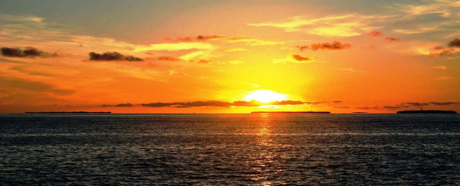 Beautiful orange sunset over an expanse of ocean, photo by Meredith Eastwood
