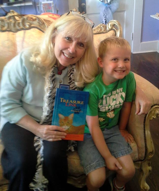 Meredith Eastwood at a book signing with grandson, Colton.