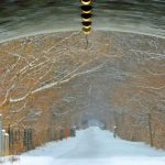 A tunnel looking out onto a snow covered walking trail, photo by Meredith Eastwood