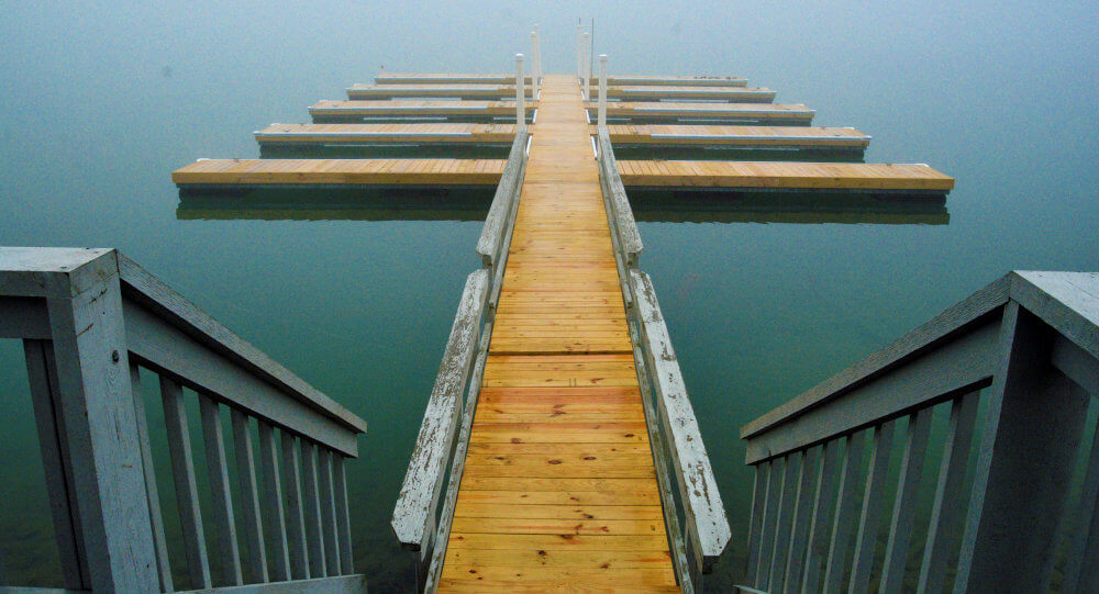 An interesting dock in the mist of morning, a very geometric structure